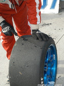 Crew member scrubs Hoosier tires