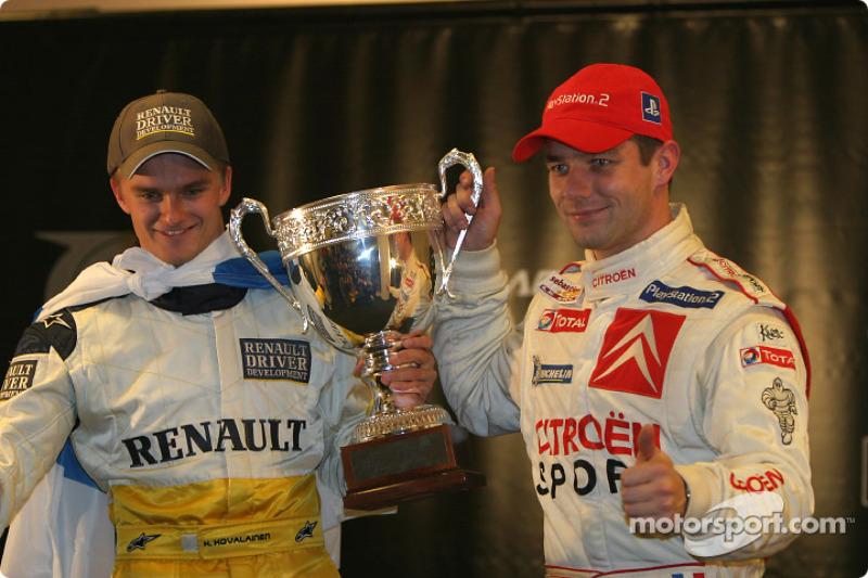 The Race of Champions 2004 winner Heikki Kovalainen with runner-up Sébastien Loeb