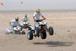 Antonio Pizzonia, Mark Webber and Nick Heidfeld on quad bikes