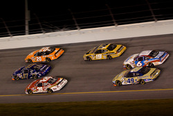 Bill Elliott, Kurt Busch and Tony Stewart go three-wide