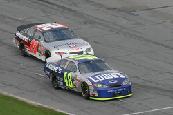 Jimmie Johnson and Kevin Harvick battle entering pit road