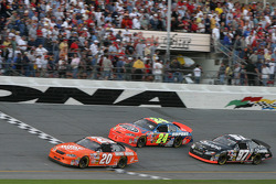 Tony Stewart, Jeff Gordon and Kurt Busch fight for the lead