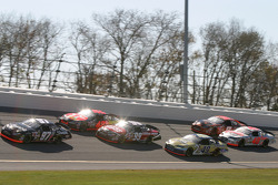 Kurt Busch leads the pack in turn 3