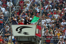 Governor of California Arnold Schwarzenegger waves the green flag to start the NASCAR Nextel Cup Auto Club 500