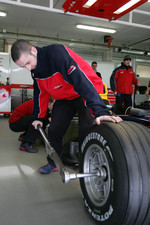 Arden International team member works on GP2 car