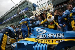 Race winner Giancarlo Fisichella celebrates with his team