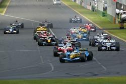 First corner: Giancarlo Fisichella leads Jarno Trulli