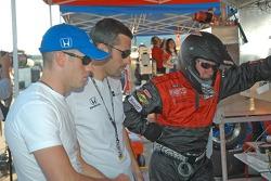 Marino and Dario Franchitti watch the race