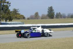 Travis Gregg spins in front of Mishael Abbott