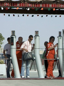 Michael Schumacher arrives at the track