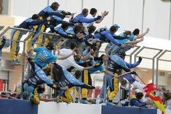 Renault F1 team members celebrate victory of Fernando Alonso
