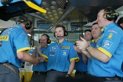 Renault F1 team members celebrate pole position of Fernando Alonso