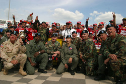 Victory lane: race winner Greg Biffle celebrates with his crew and the National Guard
