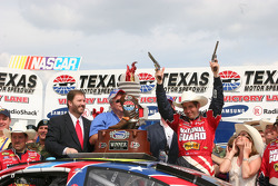 Victory lane: race winner Greg Biffle celebrates Texas style
