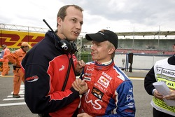 Race winner Heikki Kovalainen celebrates with his team manager