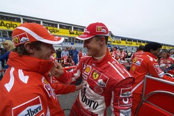 Michael Schumacher and Luca Badoer on the starting grid