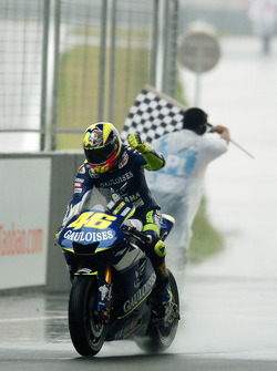 Valentino Rossi takes the checkered flag