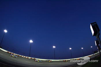 Race action under the lights at Darlington Raceway