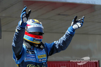 Fernando Alonso waves to his fans