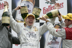 Podium: champagne shower Mika Hakkinen