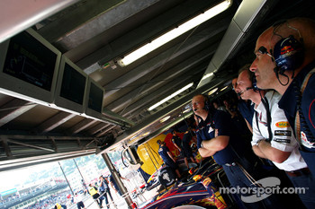Red Bull Racing crew members watch qualifying