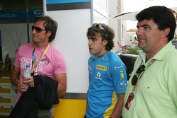 Fernando Alonso watches the race
