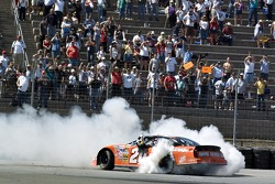 Race winner Tony Stewart celebrates with a burnout