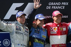 Podium: race winner Fernando Alonso with Kimi Raikkonen and Michael Schumacher