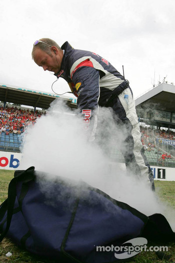 Red Bull Racing team member prepares dry ice