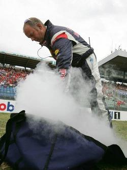 Red Bull Racing team member prepares dry ice