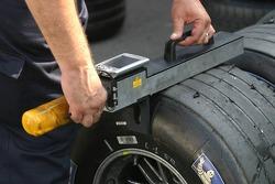 Michelin engineer checks tires