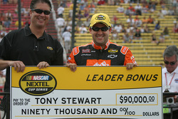Tony Stewart accepts the leader bonus check for the Brickyard 400