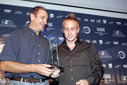 Bruno Michel presents the award for Best Driving Style to Adam Carroll