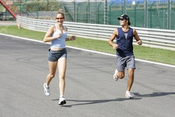 Lindsey Venn runs the Spa track with Nelson A. Piquet, to raise money for the cancer research
