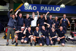 Red Bull Racing team members celebrate victory in a football match
