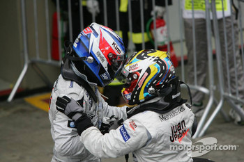 Race winner Juan Pablo Montoya with Kimi Raikkonen