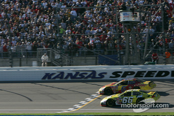 Kasey Kahne takes the checkered flag inches ahead of Greg Biffle