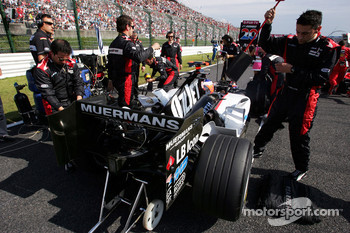 Minardi team members on the starting grid