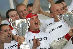 Podium: race winner Nico Rosberg celebrates