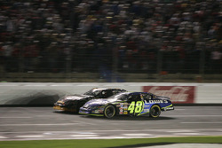 Jimmie Johnson and Joe Nemechek battle for the lead
