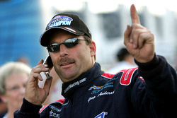 Greg Anderson talks on the phone immediatley following winning the 2005 Pro Stock division at the 5th Annual ACDelco