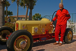 Local businessman Edward Johnson, 82, poses beside his 1934 race car.