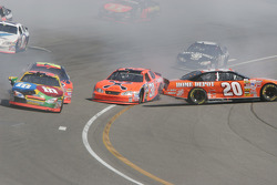 Tony Stewart spins in turn four