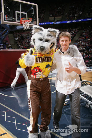 Carl Edwards and the New Jersey Nets Mascot pose for a picture during the game between the New Jersey Nets and the Detroit Pistons at the Continental Airlines Arena in East Rutherford, New Jersey