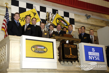 Carl Edwards, Jeremy Mayfield, Jimmie Johnson, Matt Kenseth, 2005 NASCAR Nextel Cup Champion Tony Stewart, Sprint Nextel CMO Mark Schweitzer, NASCAR President Mike Helton, Ryan Newman, Rusty Wallace, Greg Biffle, and Mark Martin pose for the media after t