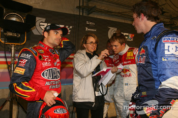 Jeff Gordon, Mattias Ekström and Travis Pastrana listen to the advices of Fabrizia Pons