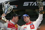 Race of Champions winner Sbastien Loeb celebrates with runner-up Tom Kristensen
