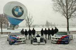 Group picture of drivers with cars in the snow