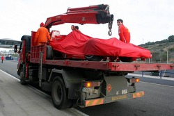 The Ferrari of Michael Schumacher is brought back to the pits