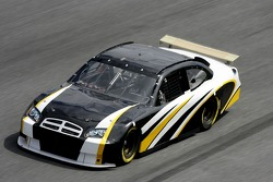 NASCAR test driver Brett Bodine, drives the NASCAR car of tomorrow with a rear wing